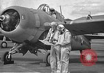 Image of LCDR John Thach and Lt. Edward O'Hare preparing for a flight Kaneohe Hawaii USA, 1942, second 8 stock footage video 65675061850
