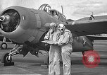 Image of LCDR John Thach and Lt. Edward O'Hare preparing for a flight Kaneohe Hawaii USA, 1942, second 10 stock footage video 65675061850