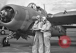 Image of LCDR John Thach and Lt. Edward O'Hare preparing for a flight Kaneohe Hawaii USA, 1942, second 11 stock footage video 65675061850