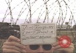 Image of view through barbed wire at airbase operations Vietnam, 1967, second 2 stock footage video 65675061936