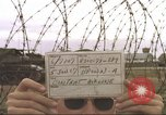Image of view through barbed wire at airbase operations Vietnam, 1967, second 4 stock footage video 65675061936