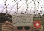 Image of view through barbed wire at airbase operations Vietnam, 1967, second 5 stock footage video 65675061936