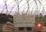 Image of view through barbed wire at airbase operations Vietnam, 1967, second 6 stock footage video 65675061936