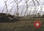 Image of view through barbed wire at airbase operations Vietnam, 1967, second 10 stock footage video 65675061936
