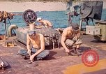 Image of U.S. Coast Guardsmen perform maintenance on LST  Iwo Jima, 1945, second 1 stock footage video 65675062154