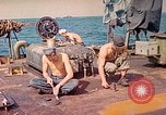 Image of U.S. Coast Guardsmen perform maintenance on LST  Iwo Jima, 1945, second 2 stock footage video 65675062154