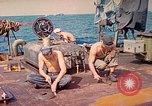 Image of U.S. Coast Guardsmen perform maintenance on LST  Iwo Jima, 1945, second 3 stock footage video 65675062154