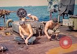 Image of U.S. Coast Guardsmen perform maintenance on LST  Iwo Jima, 1945, second 4 stock footage video 65675062154