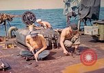 Image of U.S. Coast Guardsmen perform maintenance on LST  Iwo Jima, 1945, second 5 stock footage video 65675062154
