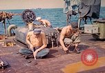 Image of U.S. Coast Guardsmen perform maintenance on LST  Iwo Jima, 1945, second 6 stock footage video 65675062154