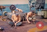 Image of U.S. Coast Guardsmen perform maintenance on LST  Iwo Jima, 1945, second 7 stock footage video 65675062154