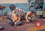 Image of U.S. Coast Guardsmen perform maintenance on LST  Iwo Jima, 1945, second 8 stock footage video 65675062154