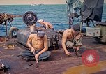 Image of U.S. Coast Guardsmen perform maintenance on LST  Iwo Jima, 1945, second 9 stock footage video 65675062154