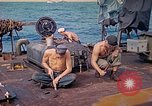 Image of U.S. Coast Guardsmen perform maintenance on LST  Iwo Jima, 1945, second 10 stock footage video 65675062154