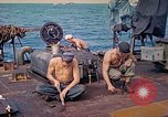 Image of U.S. Coast Guardsmen perform maintenance on LST  Iwo Jima, 1945, second 11 stock footage video 65675062154