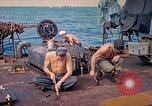 Image of U.S. Coast Guardsmen perform maintenance on LST  Iwo Jima, 1945, second 12 stock footage video 65675062154