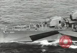 Image of Wounded transferred, ship-to-ship, on Stokes stretcher Mariana Islands, 1944, second 10 stock footage video 65675062229