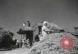 Image of Soviet farmers cutting and threshing stalks of grain during World War 2 Soviet Union, 1941, second 10 stock footage video 65675062264