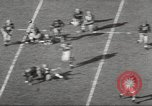 Image of football match Los Angeles California USA, 1955, second 8 stock footage video 65675062514