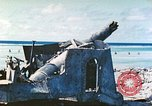 Image of Japanese coastal defense gun Tarawa Gilbert Islands, 1944, second 3 stock footage video 65675062569