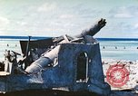 Image of Japanese coastal defense gun Tarawa Gilbert Islands, 1944, second 7 stock footage video 65675062569