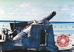 Image of Japanese coastal defense gun Tarawa Gilbert Islands, 1944, second 9 stock footage video 65675062569