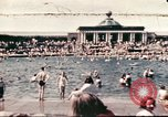 Image of Outdoor swimming pool in England England, 1943, second 1 stock footage video 65675062853