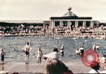 Image of Outdoor swimming pool in England England, 1943, second 2 stock footage video 65675062853
