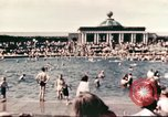 Image of Outdoor swimming pool in England England, 1943, second 3 stock footage video 65675062853