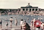 Image of Outdoor swimming pool in England England, 1943, second 4 stock footage video 65675062853