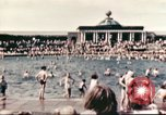 Image of Outdoor swimming pool in England England, 1943, second 5 stock footage video 65675062853