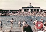 Image of Outdoor swimming pool in England England, 1943, second 6 stock footage video 65675062853