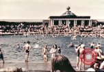 Image of Outdoor swimming pool in England England, 1943, second 7 stock footage video 65675062853