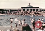 Image of Outdoor swimming pool in England England, 1943, second 8 stock footage video 65675062853