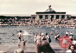 Image of Outdoor swimming pool in England England, 1943, second 9 stock footage video 65675062853