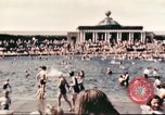 Image of Outdoor swimming pool in England England, 1943, second 10 stock footage video 65675062853