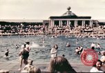 Image of Outdoor swimming pool in England England, 1943, second 11 stock footage video 65675062853