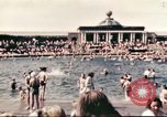 Image of Outdoor swimming pool in England England, 1943, second 12 stock footage video 65675062853