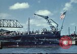 Image of USS Nevada leaving drydock after repairs Pearl Harbor Hawaii USA, 1942, second 4 stock footage video 65675062939