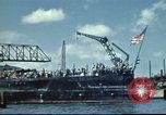 Image of USS Nevada leaving drydock after repairs Pearl Harbor Hawaii USA, 1942, second 6 stock footage video 65675062939