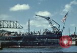 Image of USS Nevada leaving drydock after repairs Pearl Harbor Hawaii USA, 1942, second 7 stock footage video 65675062939