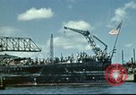 Image of USS Nevada leaving drydock after repairs Pearl Harbor Hawaii USA, 1942, second 8 stock footage video 65675062939