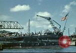 Image of USS Nevada leaving drydock after repairs Pearl Harbor Hawaii USA, 1942, second 9 stock footage video 65675062939