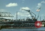 Image of USS Nevada leaving drydock after repairs Pearl Harbor Hawaii USA, 1942, second 10 stock footage video 65675062939