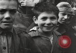 Image of European children and adults scavenge for food and relief after war Europe, 1945, second 2 stock footage video 65675063144