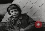 Image of European children and adults scavenge for food and relief after war Europe, 1945, second 7 stock footage video 65675063144