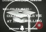 Image of hoop-rolling contest Wellesley Massachusetts USA, 1933, second 1 stock footage video 65675063201