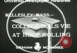 Image of hoop-rolling contest Wellesley Massachusetts USA, 1933, second 4 stock footage video 65675063201