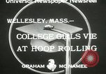 Image of hoop-rolling contest Wellesley Massachusetts USA, 1933, second 7 stock footage video 65675063201