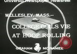 Image of hoop-rolling contest Wellesley Massachusetts USA, 1933, second 8 stock footage video 65675063201